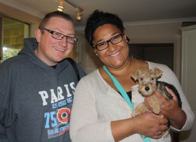 'Lola' at 9 weeks pictured with her new mum and dad 'Kirk and Tess'